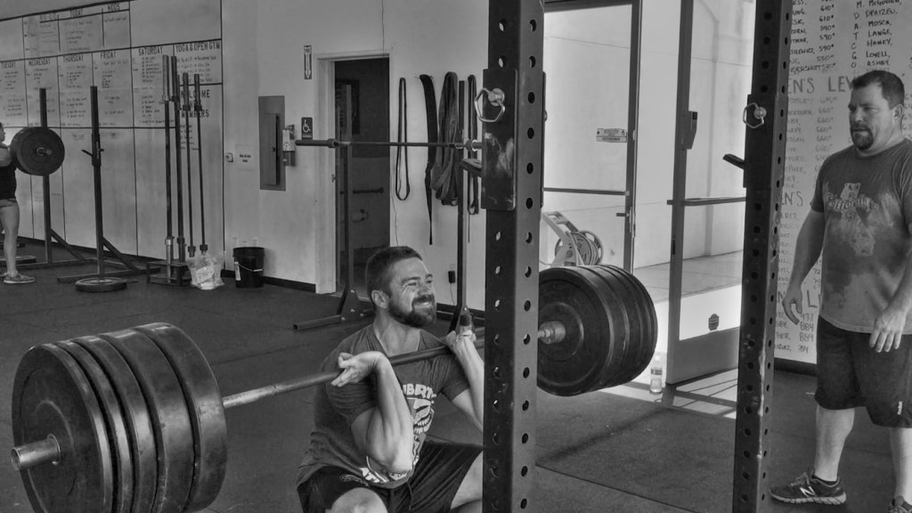 Bryan performing a 355# front squat at 178 pounds.